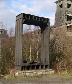 Section of the original wrought-iron tubular Britannia Bridge standing in front of the modern bridge